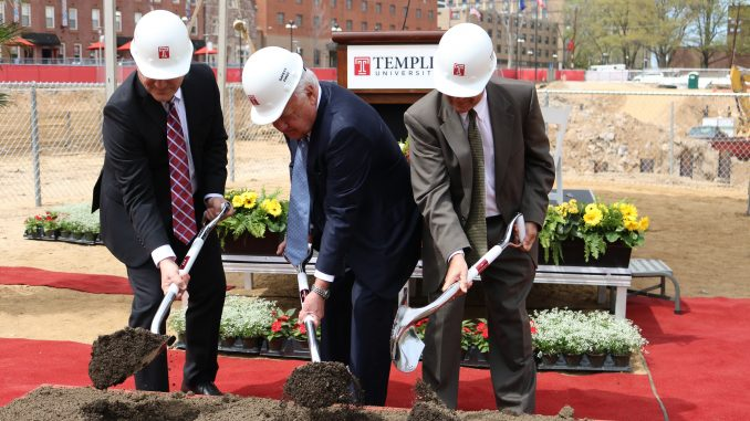 President Neil Theobald (left), Board of Trustees Chairman Patrick O'Connor and Dean of Libraries Joe Lucia symbolically break ground at the construction site for the new library. | EVAN EASTERLING TTN