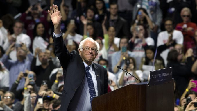 Presidential candiate Bernie Sanders waves to the crowd in the Liacouras Center Wednesday night. | JENNY KERRIGAN TTN
